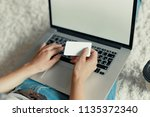 woman holding credit card and... | Shutterstock . vector #1135372340