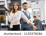 two hairstylers posing standing ...   Shutterstock . vector #1135378286