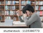 stressed asian student girl... | Shutterstock . vector #1135380773