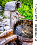 old well and bucket   photo   Shutterstock . vector #1135399148