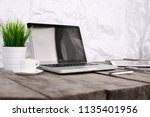 stylish workspace with computer ...   Shutterstock . vector #1135401956