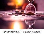 sand running through the shape... | Shutterstock . vector #1135443206