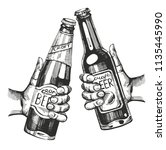 two hands with beer bootles.... | Shutterstock .eps vector #1135445990