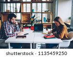 two young hipsters students... | Shutterstock . vector #1135459250