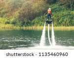child on flyboard hover in the... | Shutterstock . vector #1135460960