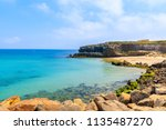 rocks on sea coast and view of... | Shutterstock . vector #1135487270