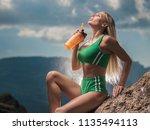 beautiful girl in sport clothes ... | Shutterstock . vector #1135494113