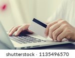 hands holding credit card and... | Shutterstock . vector #1135496570