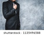 man in suit on a concrete wall... | Shutterstock . vector #1135496588