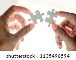 closeup hand of woman... | Shutterstock . vector #1135496594
