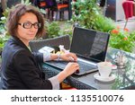 beautiful brunette using laptop ... | Shutterstock . vector #1135510076