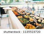 fresh cooked food in store ... | Shutterstock . vector #1135523720