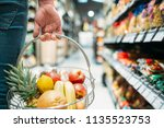male customer hand with basket  ... | Shutterstock . vector #1135523753