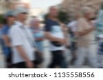 group of people walking on the... | Shutterstock . vector #1135558556