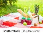 picnic basket  fruit  juice in... | Shutterstock . vector #1135570640