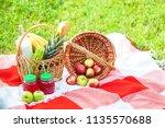 picnic basket  fruit  juice in... | Shutterstock . vector #1135570688