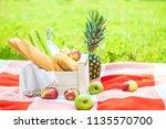 picnic basket  fruit  juice in... | Shutterstock . vector #1135570700