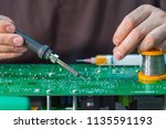 repair of the power board of... | Shutterstock . vector #1135591193