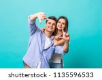 young couple make frame... | Shutterstock . vector #1135596533