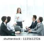 young business woman makes a... | Shutterstock . vector #1135612526