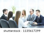business team at a meeting in... | Shutterstock . vector #1135617299