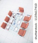 chairs and desk with documents ... | Shutterstock . vector #1135617410