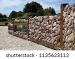 fence in the garden with pebble ... | Shutterstock . vector #1135623113