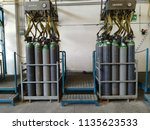 technical gas bottles in filling | Shutterstock . vector #1135623533