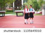 happy children girls girlfriend ... | Shutterstock . vector #1135645010