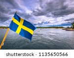swedish flag on a ferry in the... | Shutterstock . vector #1135650566