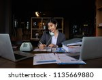 portrait of busy secretary... | Shutterstock . vector #1135669880