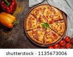delicious italian pizza sliced... | Shutterstock . vector #1135673006