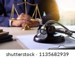 law gavel stethoscope health... | Shutterstock . vector #1135682939