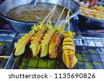 grilled squid barbecue seafood... | Shutterstock . vector #1135690826