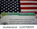 green card  permanent resident  ... | Shutterstock . vector #1135708559