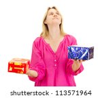 A female person juggling with two colorful gifts - stock photo