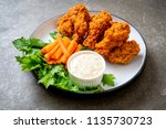 fried spicy chicken wings with vegetable