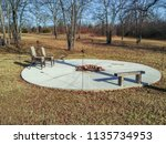 A Round Cement Patio With A...