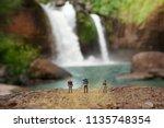 miniature backpacker with... | Shutterstock . vector #1135748354
