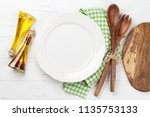 empty plate with utensils on... | Shutterstock . vector #1135753133