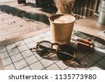 cappuccino in take away coffee... | Shutterstock . vector #1135773980