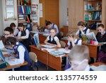 elementary school students... | Shutterstock . vector #1135774559