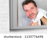 young happy and attractive man...   Shutterstock . vector #1135776698