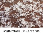 snowflakes on an old vintage... | Shutterstock . vector #1135795736