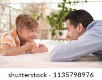 father with cute child on floor ... | Shutterstock . vector #1135798976