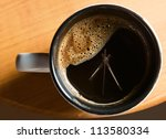Time to drink coffee , focus on a foam. - stock photo
