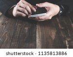 smartphone and hand | Shutterstock . vector #1135813886