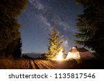 night camping in mountains.... | Shutterstock . vector #1135817546
