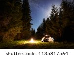 camping site at night. tourist... | Shutterstock . vector #1135817564