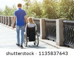 woman in a wheelchair with her... | Shutterstock . vector #1135837643
